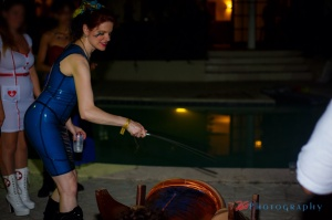 Lady Elizabeth caning an ass at DommeTrips 2014. Photo by 2G Photography.